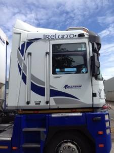 white & blue truck graphic