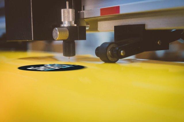 Printed stickers press main image by RAKSASIN (via Shutterstock).